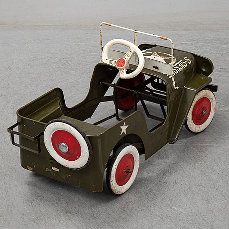 A sheet metal pedal car from the second half of the 20th century.