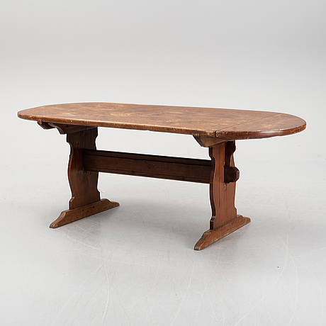A stained pine table, 19th century.