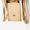 A 14k gold bracelet.