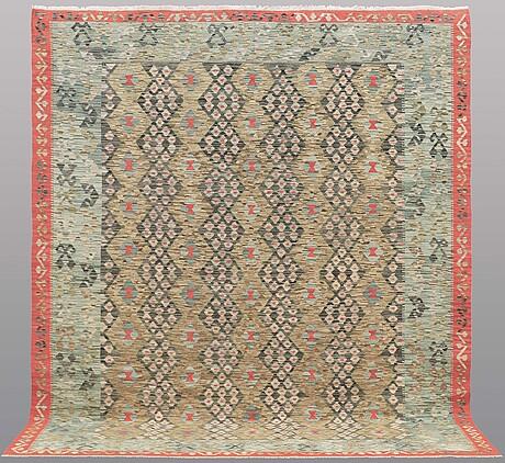 A carpet, kilim, ca 300 x 256 cm.