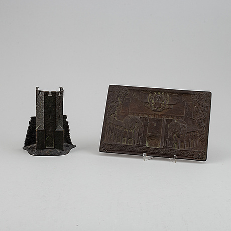 Money box and a plaque. signed. bronze. height 15 cm. plaque, 17 x 25 cm.
