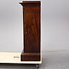 An early 19th century empire mahogany cabinet.