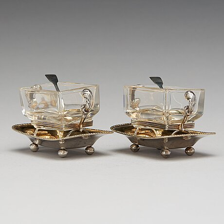 A pair of swedish 19th century parcel-gilt silver and glass jelly-bowls, mark of carl tengstedt, gothenburg 1839.