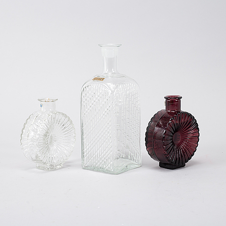 """Helena tynell, a mixed lot of two glass vases """"solflaskan"""", finland,and a nanny still square carafe, finland."""