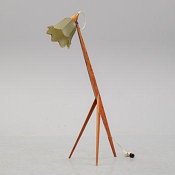 A 1950's pine floor lamp.
