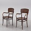 A pair of thonet armchairs from the early 20th century.