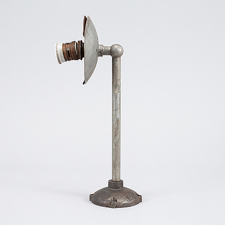 A set of four metal wall lights, first half of the 20th century.