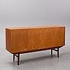 A 1950s-60s teak sideboard.