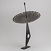 A 20th century painted metal sun dia, signed sll.