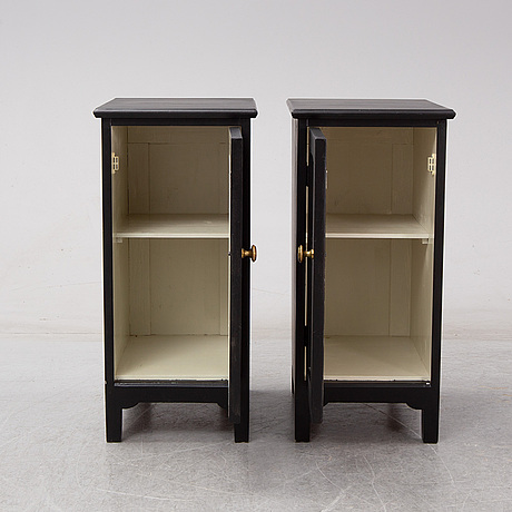 A pair of early 20th century bedside tables / cupboards.