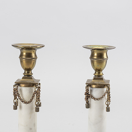 A pair of gustavian style candlesticks ca 1900.