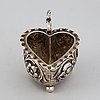 A small silver baroque style  heart-shaped jug on ball feet.