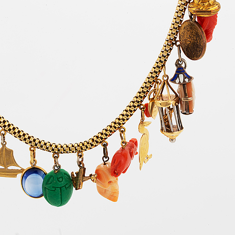 18k gold necklace with charms.