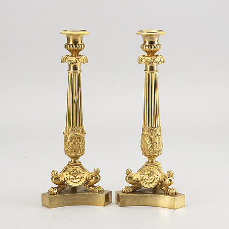 A pare of late empire candelsticks mid 19th century.
