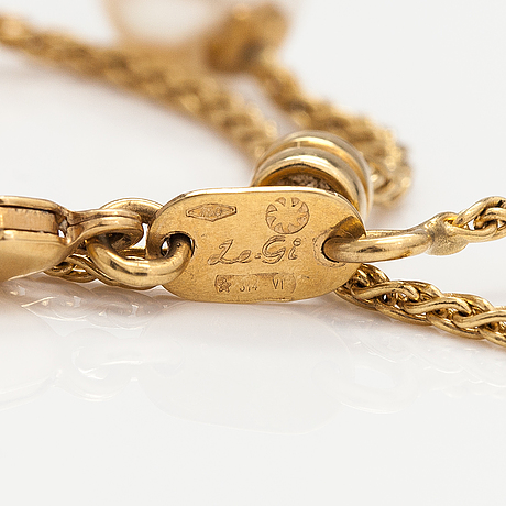 An 18k gold necklace with cultured pearls. le-gi, italy.