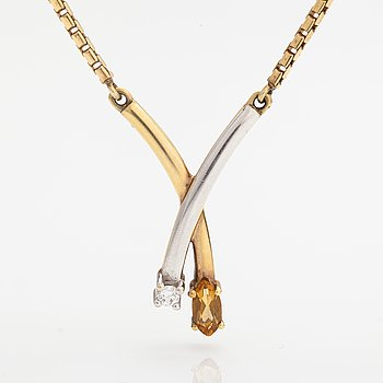 A 14K gold necklace with a citrine and a diamond ca. 0.04 ct.