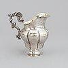 A swedish 19th century parcel-gilt silver cream-jug, mark of oskar ahlström, södertälje 1856.