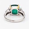 An 18k white gold ring with diamonds ca. 0.44 ct in total and an emerald ca. 5.46 ct in total. import marked itd, espoo.