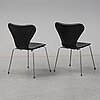Two 'serie 7' chairs by arne jacobsen for fritz hansen. removable black leather upholstery.