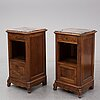 A pair of walnut marble top bedside tables, first half of the 20th century.