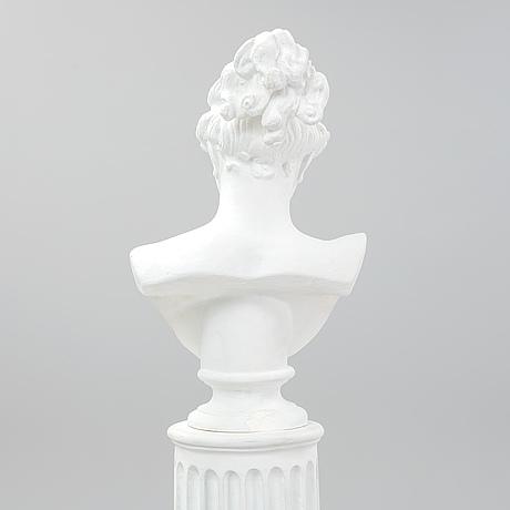 A plaster bust and pedestal.