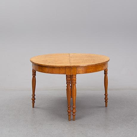 A burr birch veneere dining table, second half of the 20th century.