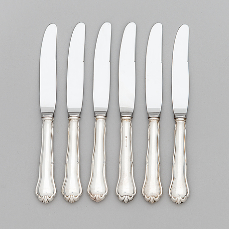 A 24-piece set of 'chippendale' silver cutlery, finnish hallmarks 1987-91.