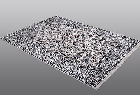 A rug, nain, part, silk, ca 230 x 158 cm.