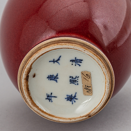 A sang de boef glazed vas, late qing dynasty with kangxi six character mark.
