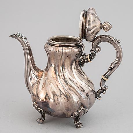 A silver coffee pot, creamer, sugar bowl and tray, swedish import mark.