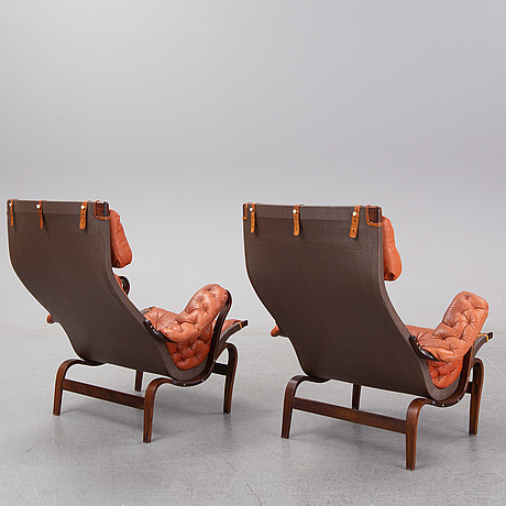 An end of the 20th century pair of 'pernilla' easy chairs with leather upholstery by bruno mathsson for dux.