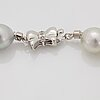 A cultured south sea pearl necklace with a detachable cultured south sea pearl pendant.