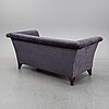 A 21st century 'cotton club' sofa from lambert.
