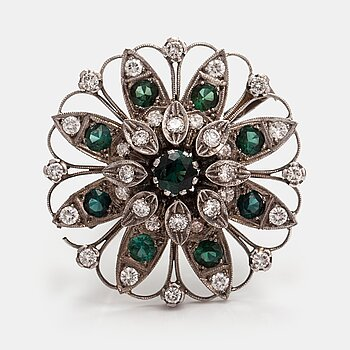 A 18K white gold brooch with tourmalines and brilliant-cut diamonds ca. 0.96 ct in total. Timanttikoru, Helsinki 1967.