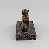 A 19/20th century bronze and porphyry paperweight.