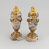 A pair of marble urns with bronze mountings from around year 1900.