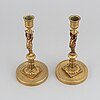 A pair of 19th century bronze empire style candlesticks.