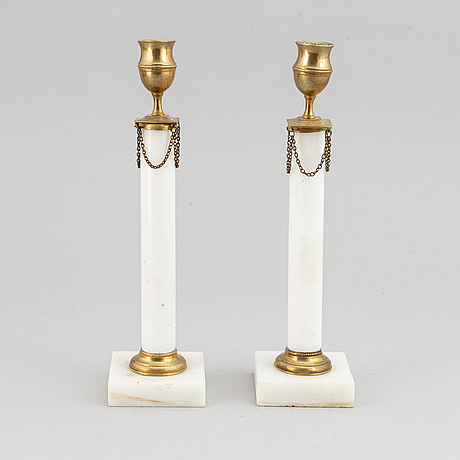 A 20th century pair of late gustavian style marble and brass candle sticks.