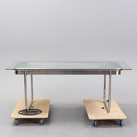 A glass and steel dining table, 1970's.