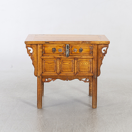 A chniese tabel wiht two drawers.