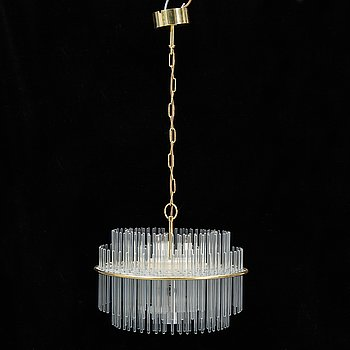 A brass ceiling lamp/chandelier with glass staves by Gaetano Sciolari, sencond half of the 20th century.