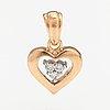 A 14k gold pendant with diamonds ca. 0.045 ct in total. einari ailio, jyväskylä.