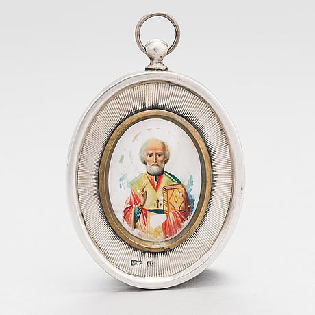 A silver and mother-of-pearl icon, russian import mark, moscow 1908-17.