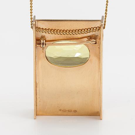 Markku liitola, a 14k gold necklace/brooch with a heliodor/yellow beryl. turku 1992.