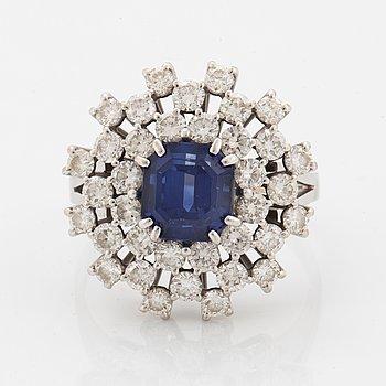 A sapphire and brilliant cut diamond ring.