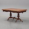 A first halg of the 20th century walnut veneered table.