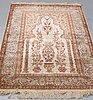 A rug, old, silk hereke, souf, ca 132 x 109 cm.