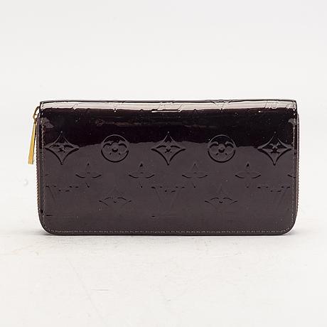 A louis vuitton wallet 'zippy'.