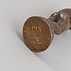 Astri bergman-taube, sculpture/stamp, signed.