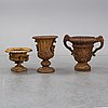 Two 19th century cast iron urns.